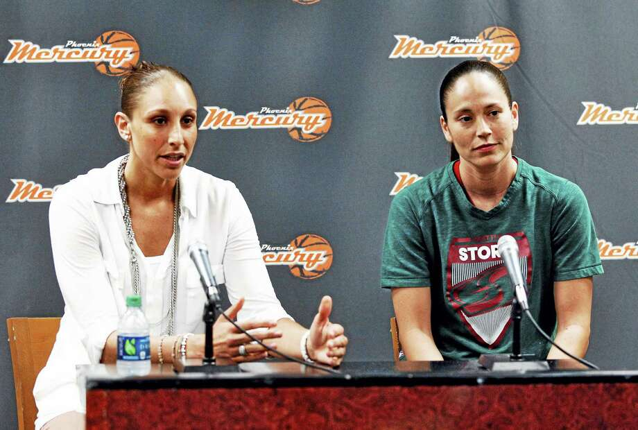 Former UConn teammates Diana Taurasi, left, and Sue Bird talk during a 2012 press conference. Photo: The Associated Press File Photo  / AP
