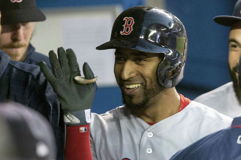 Boston Red Sox second baseman Eduardo Nunez celebrates in the dugout after hitting a solo home run off Toronto Blue Jays starting pitcher Marcus Stroman during the third inning of Boston's 6-5 victory Monday. Photo: Chris Young — The Canadian Press Via AP  / The Canadian Press