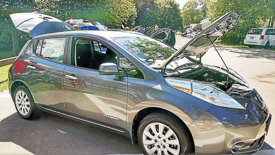 Over 25 electric and hybrid cars were on display at the electric car show '17 at Sears Park in East Hampton Sept. 10th. Photo: Pat Petrone Photo