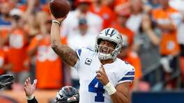Dallas Cowboys quarterback Dak Prescott throws as Denver Broncos outside linebacker Von Miller pursues during the second half of the Broncos' 42-17 victory Sept. 17.