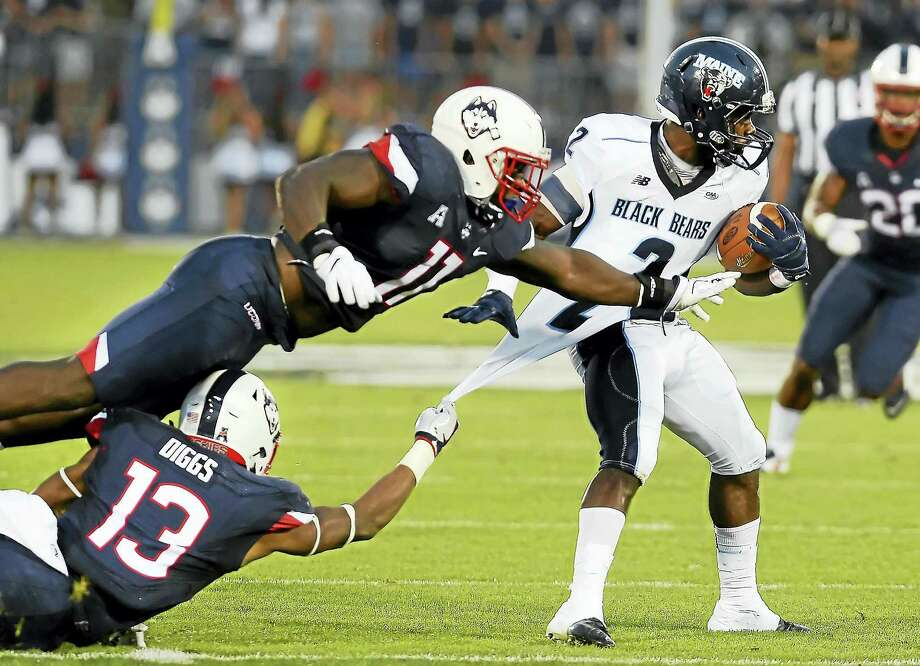 UConn's Vontae Diggs (13), bottom left, will be returning from a preseason knee injury against Virginia on Saturday. Photo: ASSOCIATED PRESS FILE PHOTO  / AP2016
