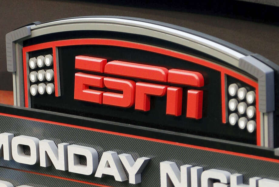 """This Sept. 16, 2013 photo shows the ESPN logo prior to an NFL football game between the Cincinnati Bengals and the Pittsburgh Steelers, in Cincinnati. ESPN sideline reporter Sergio Dipp became an unlikely star of """"Monday Night Football"""" thanks to an awkward debut on the broadcast during the Denver Broncos-Los Angeles Chargers game on Sept. 11, 2017. Photo: AP Photo — David Kohl, File  / FR51830 AP"""