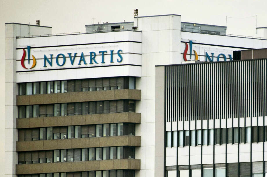 This Oct. 25, 2011 photo shows the logo of Swiss pharmaceutical company Novartis AG on one of their buildings in Basel, Switzerland. According to results published Sunday, Aug. 27, 2017, for the first time, a drug has helped prevent heart attacks by curbing inflammation, a new and very different approach than lowering cholesterol, which has been the main focus for decades. Canakinumab's maker, Novartis, sponsored the study. Photo: Georgios Kefalas — Keystone Via AP, File  / Keystone