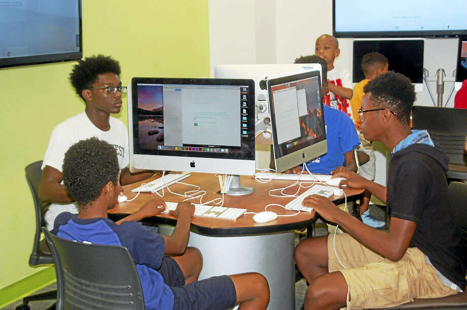 Area youth learn how to code apps at Middlesex Community College's programming camp in Middletown. Photo: Contributed Photo