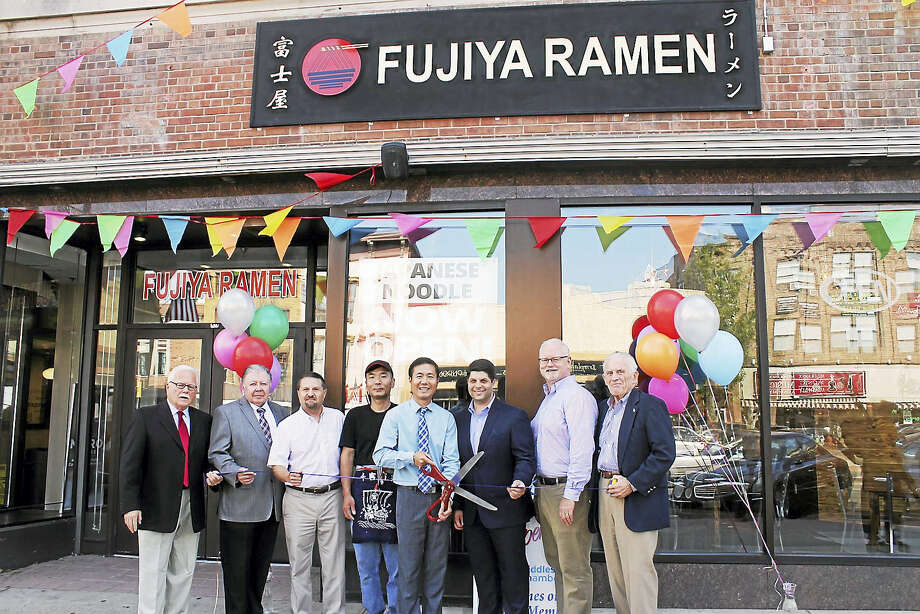 Fujiya Ramen held a grand opening Aug. 21 at 425 Main St., Middletown. From left are Middletown Small Business Development Counselor Paul Dodge, Vice Chairman, Middlesex County Chamber of Commerce Jay Polke, Chamber Chairman Rick Morin, Fujiya Ramen cook and partner Jackie Chen, owner Andy Liu, Middletown Mayor Dan Drew, Chairman of the Chamber's Central Business Bureau Thomas Byrne, and Chamber President Larry McHugh. Photo: Contributed Photo
