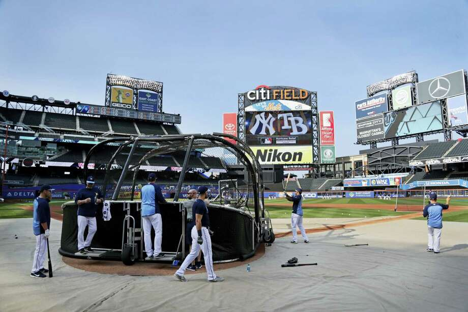 Tampa Bay Rays players warm up at Citi Field before Monday's game against the Yankees in New York. Photo: Frank Franklin II — The Associated Press  / Copyright 2017 The Associated Press. All rights reserved.