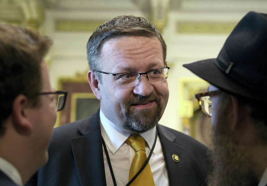 In this Tuesday, May 2, 2017 file photo, deputy assistant to President Trump, Sebastian Gorka, talks with people in the Treaty Room in the Eisenhower Executive Office Building on the White House complex in Washington during a ceremony commemorating Israeli Independence Day. White House national security aide Sebastian Gorka tells The Associated Press he has resigned from his position, Friday, Aug. 25, 2017. Photo: AP Photo/Susan Walsh, File  / Copyright 2017 The Associated Press. All rights reserved.