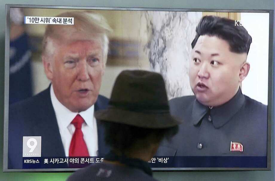 In this Aug. 10, 2017 photo, a man watches a television screen showing U.S. President Donald Trump and North Korean leader Kim Jong Un during a news program at the Seoul Train Station in Seoul, South Korea. Photo: AP Photo — Ahn Young-joon, File  / Copyright 2017 The Associated Press. All rights reserved.