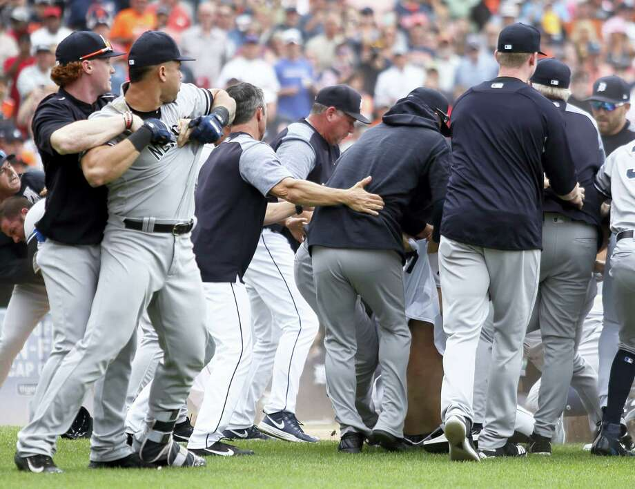 The Yankees' Clint Frazier, left, tries to restrain Gary Sanchez during a bench-clearing brawl with the Tigers in the sixth inning on Thursday in Detroit. Photo: Duane Burleson — The Associated Press   / FR38952 AP