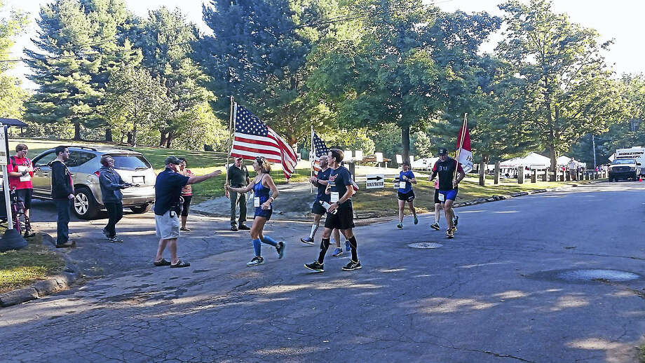 Runners return from their 5-mile loop during the 2016 Run for the Fallen at Veterans Park in Middletown. Photo: File Photo
