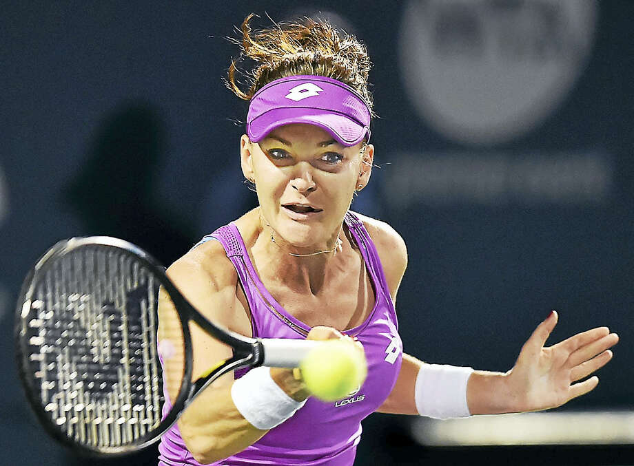 Connecticut Open defending champion Agnieszka Radwanska returns a volley against Shuai Peng on Thursday. Photo: Catherine Avalone/Hearst Connecticut Media  / New Haven Register