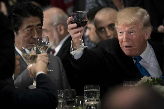 US President Donald Trump (R) raises his glass to a toast by UN Secretary-General Antonio Guterres, with Japan's Prime Minister Shinzo Abe (L), and others during a luncheon at the United Nations headquarters during the 72nd session of the United Nations General Assembly September 19, 2017 in New York. / AFP PHOTO / Brendan SmialowskiBRENDAN SMIALOWSKI/AFP/Getty Images