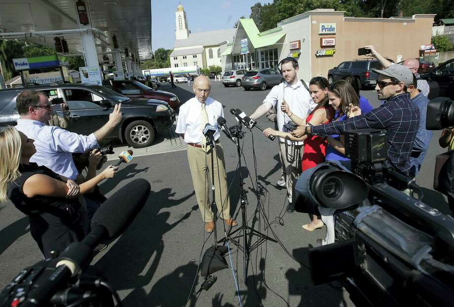 Bob Bolduc, founder and owner of Pride stores, center, takes questions from members of the media during a news conference at the Pride Station & Store, Thursday, Aug. 24, 2017, in Chicopee, Mass., where the lone winning ticket for the $758.7 million Powerball drawing was sold. Photo: AP Photo/Steven Senne   / Copyright 2017 The Associated Press. All rights reserved.