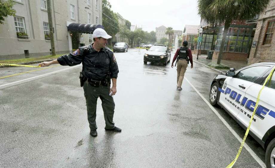 Charleston, S.C., Police Department blocks the street during an active hostage situation in Charleston, S.C., on Thursday, Aug. 24, 2017.  Authorities say a disgruntled employee shot one person and is holding hostages in a restaurant in an area that is popular with tourists. Mayor John Tecklenburg said at a news conference that the shooting was not an act of terrorism or racism. Photo: AP Photo/Mic Smith   / Mic Smith Photography LLC