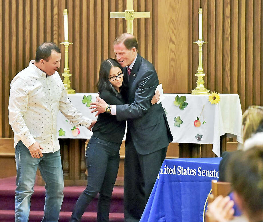 (Peter Hvizdak /  Hearst Media Connecticut) Marco Reyes, of Meriden, an undocumented immigrant from Ecuador, left, his daughter Evelyn Reyes, a DACA recipient, center, after sharing their story regarding their family's deportation fight, center, with Senator Richard Blumenthal (D-Conn.) during an emergency field hearing to gather firsthand testimony Monday at the First and Summerfield Church in New Haven. Photo: Hearst Connecticut Media / New Haven Register