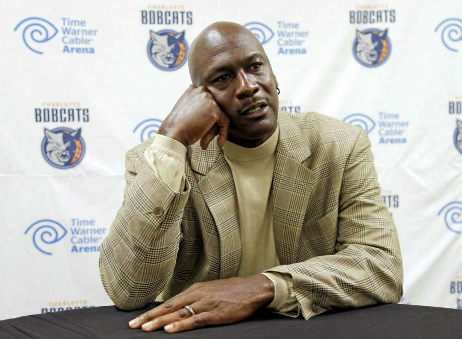 Charlotte Bobcats owner Michael Jordan listens to a question during an interview with The Associated Press about his NBA basetball team Nov. 1, 2013 in Charlotte, N.C. Photo: AP Photo — Chuck Burton  / AP