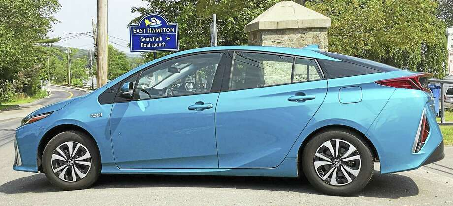 "9-9-17 News Release:  East Hampton ""Electric Car Show '17"" at Sears Park   Photo Caption: This 2017 Toyota Prius Plug-In Hybrid will be one of the vehicles at the ""Electric Car Show"" that will be held at Sears Park in East Hampton on Sept. 9th. Pamela Rinaldi The East Hampton Clean Energy Task Force, a volunteer committee dedicated to promoting green energy alternatives for our town, is proud to announce the first ""Electric Car Show,"" being held on Saturday, September 9, 2017 at Sears Park from 12 noon to 4 pm. Sept. 23 will be the rain date. Come join us at the lake as we showcase electric, hybrid, and alternative fuel cars from various dealerships including Chevrolet, Ford, Chrysler, Toyota, BMW, and more. We are also inviting any town residents who own any electric, hybrid, or alternative fuel vehicle to show off their clean energy machine too. There is no registration fee, but the deadline to register your vehicle for the show is Friday, September 1. You can register by contacting the East Hampton Clean Energy Task Force at ehcetf@gmail.com or call us 860-365-1296. Town residents are also invited to show off other vehicles too, not just cars – bikes, scooters or anything that moves are all welcome! Registration is also open, at no charge, to any town groups, non-profits, associations or clubs that would like to have a booth at the show to educate and inform the town. It's a terrific way to let people know more about you while we all learn more about electric, hybrid, and alternative fuel vehicles and have some fun down at the lake! We'll have music, raffles, and food provided by the Dublin Beef & Seafood Company, too! Booth registration forms can be found by emailing the East Hampton Clean Energy Task Force at ehcetf@gmail.com or call us at 860-365-1296. So, come on out, show off your ride or just do some green window-shopping with us and have some good ""clean"" fun! Photo: CREDIT HERE"