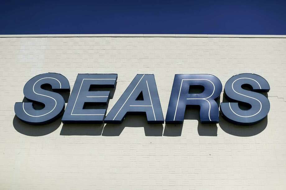 This Wednesday photo shows a Sears sign outside the department store at the Tri-County Mall, in Springdale, Ohio. Sears Holdings Corp. reports earnings, Thursday. Photo: John Minchillo — The Associated Press  / AP