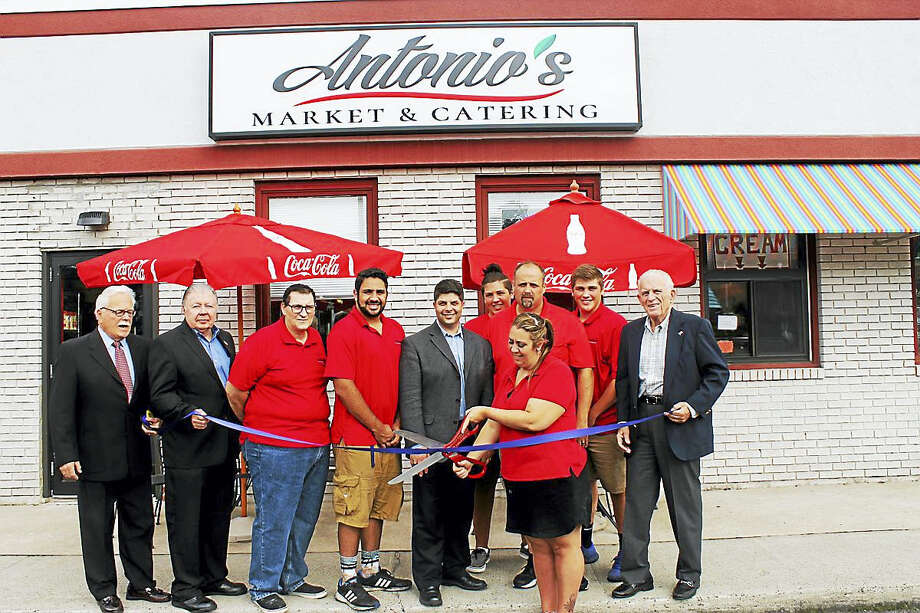 Antonio's Market & Catering held a grand opening on Aug. 8 at 650 South Main St. in Middletown. Middlesex County Chamber of Commerce President Larry McHugh joined Antonio Lockwood, Matt Lockwood and Carmela Lockwood, along with other family and staff members with city and business officials, the official opening of the customer-oriented deli, market and caterer. Photo: Contributed Photo