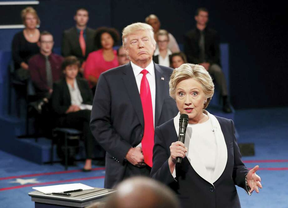 In this Oct. 9, 2016 file photo, Democratic presidential nominee Hillary Clinton, right, speaks as Republican presidential nominee Donald Trump listens during the second presidential debate at Washington University in St. Louis, Sunday, Oct. 9, 2016. Photo: Rick T. Wilking/Pool Via AP   / Copyright 2016 The Associated Press. All rights reserved.