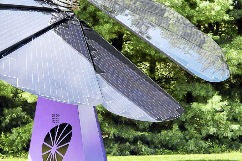 "Inspired by sunflowers and other phototropic plants that follow the sun across the horizon, SmartFlower ""wakes up"" at sunrise, fans out 12 solar ""petals"" to 194 square feet and automatically cleans itself in preparation for capturing the sun's rays. Photo: Cassandra Day — Hearst Connecticut Media"
