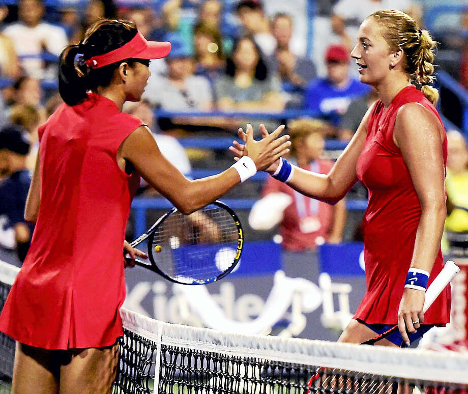 Shuai Zhang of China shakes hands with Petra Kvitova of the Czech Republic after defeating Kvitova 6-2, 6-1 during the first round of the Connecticut Open tennis tournament on Stadium Court at the Connecticut Tennis Center in New Haven. Photo: Peter Hvizdak / Hearst Connecticut Media  / New Haven Register