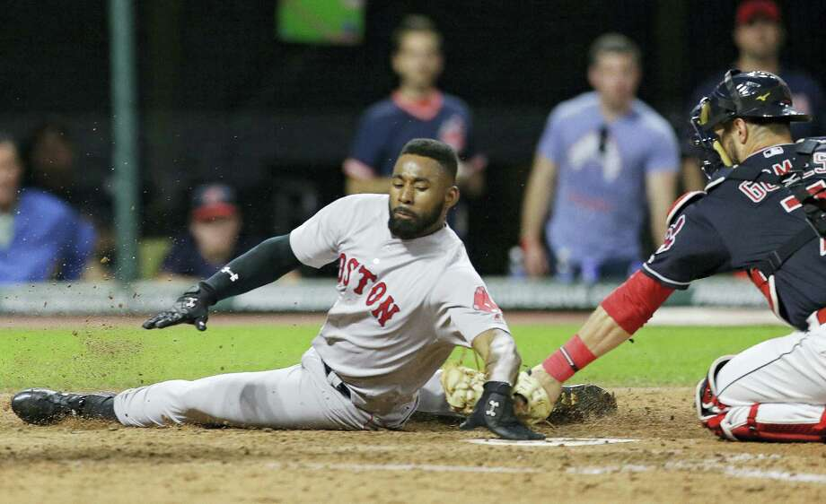 Boston's Jackie Bradley Jr. slides safely into home plate as Cleveland Indians catcher Yan Gomes is late on the tag in the seventh inning. Bradley Jr. scored on a two-run double hit by Eduardo Nunez in Boston's 9-1 victory. Photo: TONY DEJAK - THE ASSOCIATED PRESS  / AP 2017