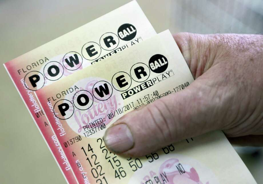 In this Aug. 18, 2017 photo, a customer shows his purchased Powerball tickets in Hialeah, Fla. The estimated jackpot for the Aug. 23, 2017 Powerball lottery game has climbed to $700 million, making it the second-largest in U.S. history. Photo: AP Photo — Alan Diaz, File  / Copyright 2017 The Associated Press. All rights reserved.