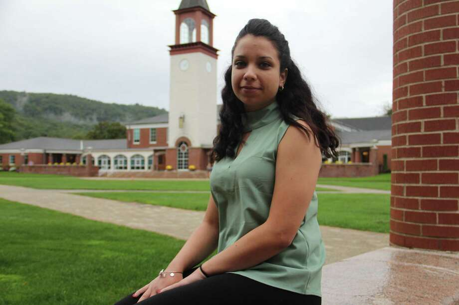Quinnipiac University senior Shelma Morales, of New Britain, sits outside the Carl Hansen Student Center on Tuesday, Sept. 19, in Hamden. Morales, who majors in biomedical sciences, is from Puerto Rico and was one of several students whose families face possible impact from Hurricane Maria. Photo: Esteban L. Hernandez / Hearst Connecticut Media / Esteban L. Hernandez / Hearst Connecticut Media