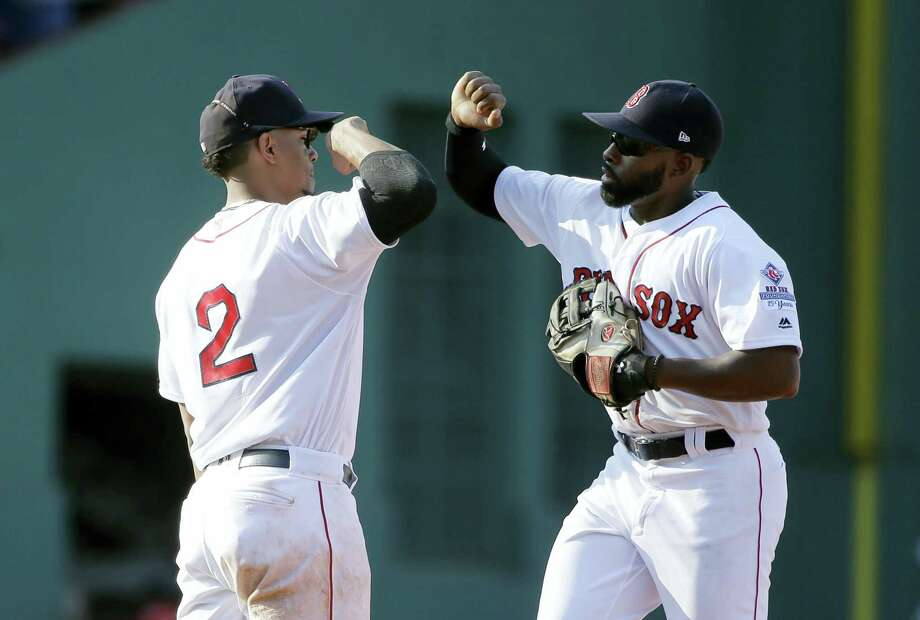 Xander Bogaerts, left, celebrates with Jackie Bradley Jr. after the Red Sox beat the Yankees on Sunday. Photo: Steven Senne — The Associated Press  / Copyright 2017 The Associated Press. All rights reserved.