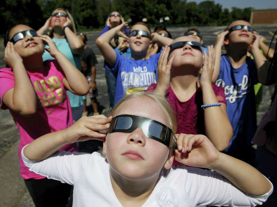 Schools around the country preparing for the solar eclipse are reacting in a variety ways, with some using the event for a full day of science lessons and others closing to avoid the crush of crowds expected in their towns. Photo: AP Photo — Charlie Riedel  / Copyright 2017 The Associated Press. All rights reserved.