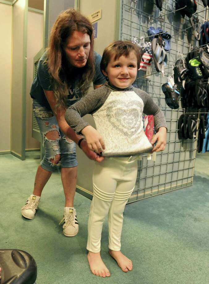Cena Matthias helps her daughter Natasia Mitchell, 4, choose an outfit while doing some back-to-school shopping at Boscov's on Friday, Aug. 18, 2017. Photo: John Rucosky — The Tribune-Democrat Via AP  / The Tribune-Democrat