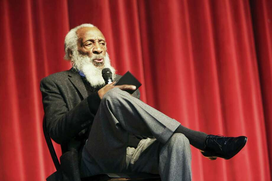 In this Jan. 20, 2016 photo, long time civil rights activist, writer, social critic, and comedian Dick Gregory, talks to the crowd at the 16th annual Tampa Bay Black Heritage Festival, MLK Leadership Luncheon, at the University Area Community Development Center, in Tampa, Fla. Gregory died late Saturday, Aug. 19, 2017, in Washington, D.C. after being hospitalized for about a week, his son Christian Gregory told The Associated Press. Photo: Scott Keeler  — Tampa Bay Times Via AP  / Tampa Bay Times