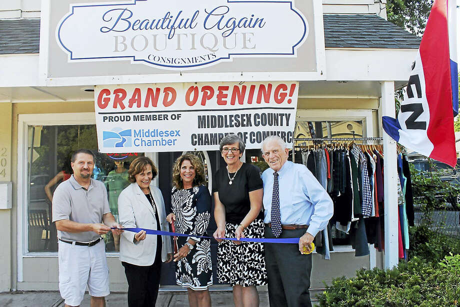 Beautiful Again Boutique held a grand opening Aug. 10 at 204 Main St., Portland. Shown, from left, are: Middlesex County Chamber of Commerce Chairman Rick Morin, Portland First Selectman Susan Bransfield, owner Liz Rogers, Portland Economic Development Consultant Mary Dickerson and Chamber President Larry McHugh. Photo: Contributed Photo