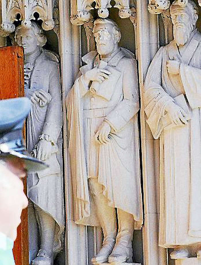 In this Aug. 17, 2017, file photo, the defaced Gen. Robert E. Lee statue, center, stands at the Duke Chapel in Durham, N.C. Duke Duke University removed a statue of Gen. Robert E. Lee early Saturday, Aug. 19, days after it was vandalized amid a national debate about monuments to the Confederacy. The university said it removed the carved limestone likeness early Saturday morning from Duke Chapel where it stood among 10 historical figures depicted in the entryway. Photo: Bernard Thomas/The Herald-Sun Via AP, File   / The Herald-Sun