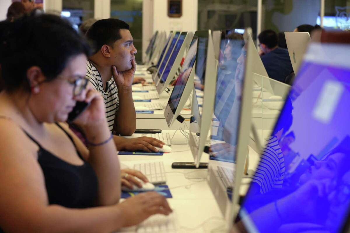 Luis Villanueva, 24, works on a computer at the BiblioTech South facilities on Pleasanton Road, Tuesday, Sept. 19, 2017. The Bexar County's digital library is in its fourth year of existence.