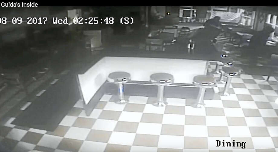 Screenshot from a surveillance video from inside Guida's in Middlefield when an ATM was stolen. Photo: Courtesy Of Connecticut State Police