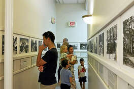"""Visitors at the The Sharon Town Hall Art Gallery, at 63 Main St. look at a show entitled """"Female Perspective,"""" featuring recent work by local artists Linda Amerighi, Eve Biddle, Purdy Eaton and Tara Lisa Foley during the first annual Sharon Art Walk."""