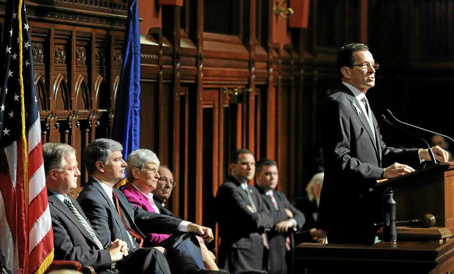 Gov. Dannel P. Malloy, right, outlines his budget proposals during a joint session of the General Assembly at the Capitol in Hartford. Photo: Jessica Hill / AP File / FR125654 AP