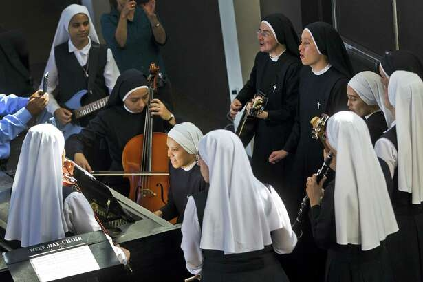 """In this Sept. 7, 2017 photo, members of """"Siervas,"""" a Peruvian-based rock 'n' roll band comprised entirely of Catholic nuns, rehearse a day ahead of their performance at the Christ Cathedral campus in Garden Grove, Calif. The sisters insist they aren't rock stars though they're being considered for a nomination for a Latin Grammy and their concerts draw thousands."""