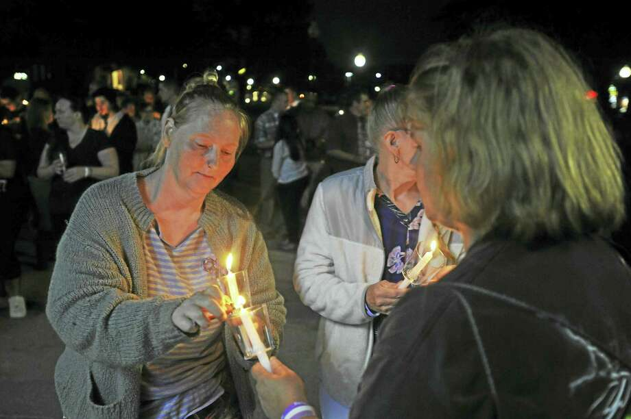Ben Lambert / Hearst Connecticut Media A candlelight vigil and resource fair by the Litchfield County Opiate Task Force was held Thursday evening in Coe Park in Torrington. Above, guests light candles during the event. Photo: Digital First Media