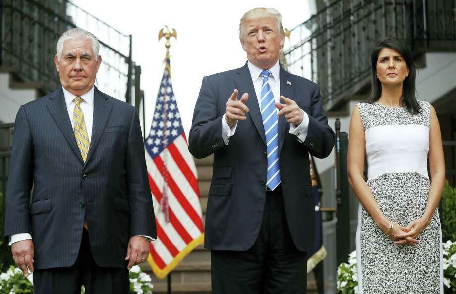 President Donald Trump gestures while speaking following his meeting with Secretary of State Rex Tillerson, left, and U.S. Ambassador to the United Nations Nikki Haley at Trump National Golf Club in Bedminster, N.J., Friday, Aug. 11, 2017. Photo: Pablo Martinez Monsivais / AP Photo  / Copyright 2017 The Associated Press. All rights reserved.