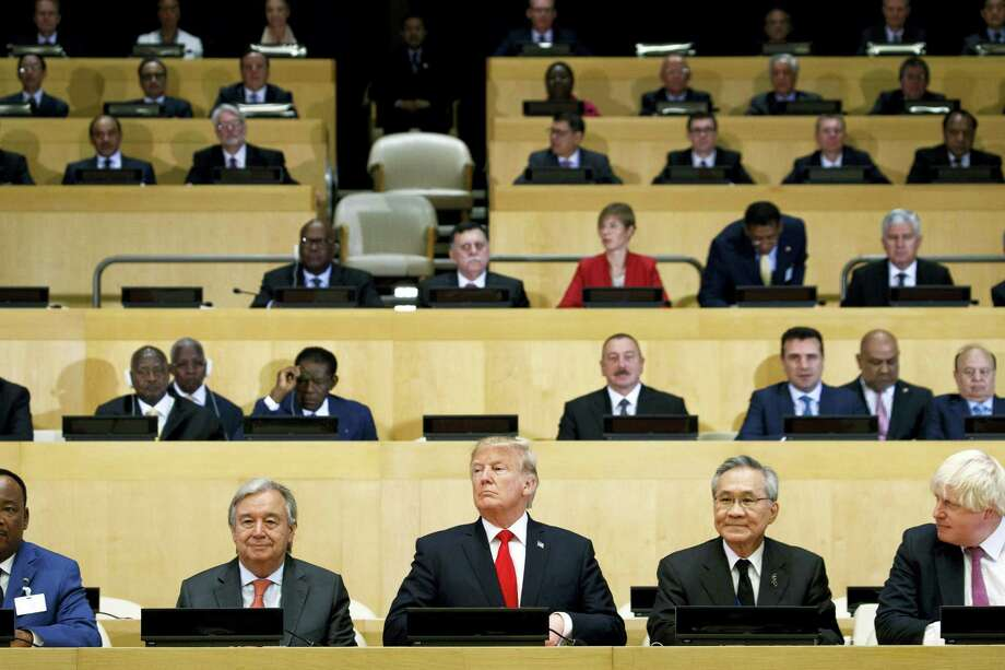 """President Donald Trump participates in a photo before the beginning of the """"Reforming the United Nations: Management, Security, and Development"""" meeting during the United Nations General Assembly on Sept. 18, 2017, at U.N. headquarters. Photo: AP Photo — Evan Vucci  / Copyright 2017 The Associated Press. All rights reserved."""