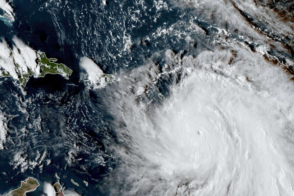 This Monday, Sept. 18, 2017, GOES East satellite image provided by NASA taken at 20:30 UTC, shows the eye of Hurricane Maria as it nears Dominica. The National Hurricane Center in Miami said Monday evening that Air Force Reserve hurricane hunter planes found that Maria had strengthened into a storm with 160 mph (260 kph) winds.