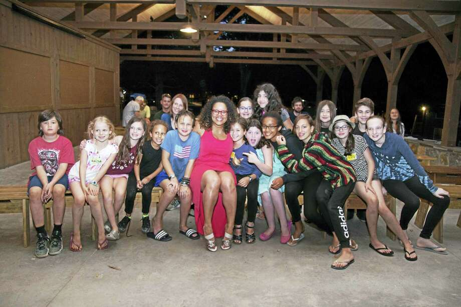 Above, campers at Bucks Rock join Kimberly Locke, an American Idol finalist, during her visit on Aug. 16. Photo: Photo By Lora Karam
