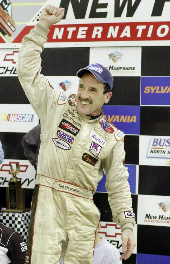 In this Sept. 16, 2005 photo, Ted Christopher celebrates his victory in the Busch North Series Sylvania 125 at the New Hampshire International Speedway in Loudon, N.H. NASCAR officials say modified championship racer Christopher was one of two people killed when a small plane crashed in Connecticut. The Federal Aviation Administration confirms that two people were aboard a Mooney M20C plane that went down in a wooded area near the North Branford-Guilford border shortly before 2 p.m. Saturday, Sept. 16, 2017. NASCAR says Christopher and the plane's pilot died. Photo: AP Photo — Jon-Pierre Lasseigne, File  / Copyright 2017 The Associated Press. All rights reserved.