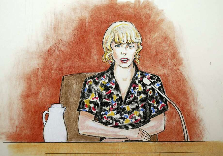 In this courtroom sketch, pop singer Taylor Swift speaks from the witness stand during a trial Thursday, Aug. 10, 2017, in Denver. Swift testified Thursday that David Mueller, a former radio DJ, reached under her skirt and intentionally grabbed her backside during a meet-and-a-greet photo session before a 2013 concert in Denver. Photo: Jeff Kandyba Via AP  / Copyright 2017 The Associated Press. All rights reserved.