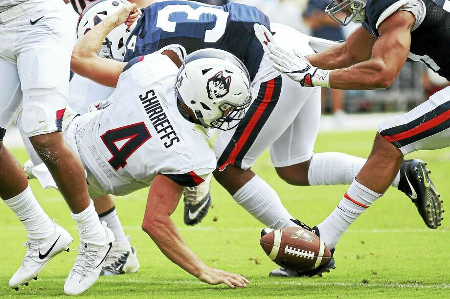 UConn's Bryant Shirreffs loses a fumble during Saturday's game against Virginia. Photo: Ryan M. Kelly/Getty Images  / 2017 Getty Images