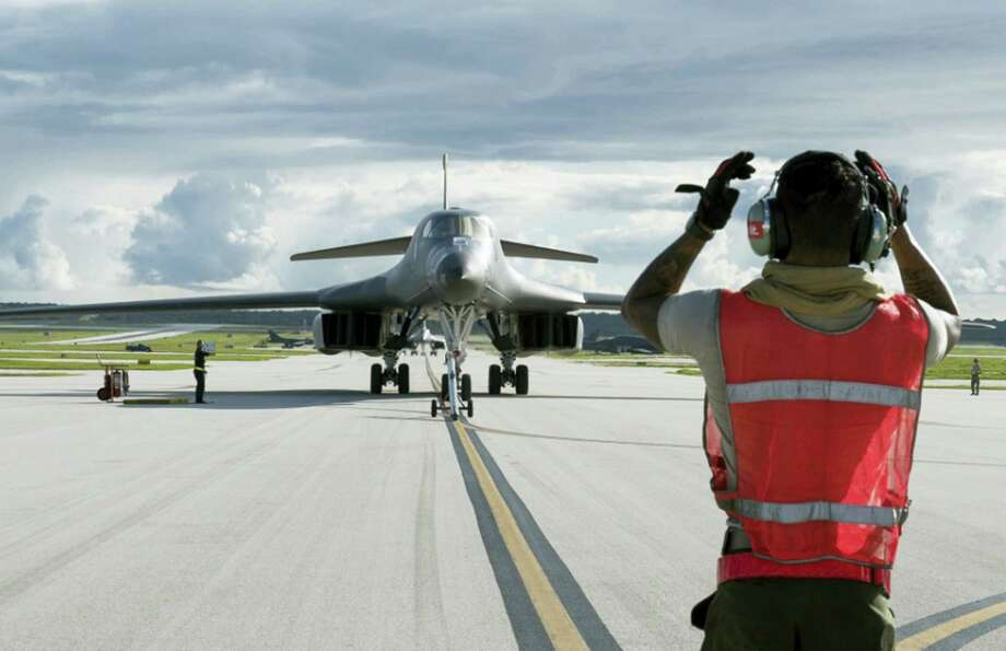 "In this photo provided by the U.S.Air Force, taken July 26, 2017, a U.S. Air Force B-1B Lancer arrives at Andersen Air Force Base, Guam. President Donald Trump issued a new threat to North Korea on Thursday, Aug. 10, 2017, demanding that Kim Jong Un's government ""get their act together"" or face extraordinary trouble. He said his previous ""fire and fury"" warning to Pyongyang might have been too mild. Photo: U.S. Air Force By Tech. Sgt. Richard P. Ebensberger Via The AP  / U.S. Air Force"