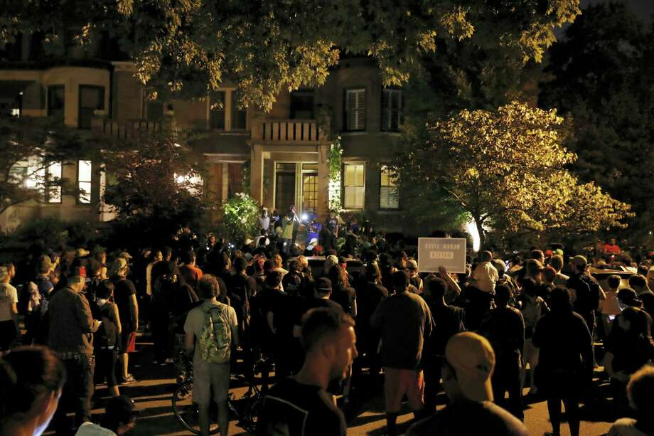 Protesters gather in front of the home of St. Louis Mayor Lyda Krewson, Friday, Sept. 15, 2017, in St. Louis, after a judge found a white former St. Louis police officer, Jason Stockley, not guilty of first-degree murder in the death of a black man, Anthony Lamar Smith, who was fatally shot following a high-speed chase in 2011. Photo: AP Photo/Jeff Roberson   / Copyright 2017 The Associated Press. All rights reserved.